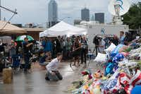 Media crews capture mourners in downtown Dallas on July 10(Christian Vasquez/Special Contributor)
