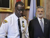 Cleveland Police Chief Calvin Williams, with Mayor Frank Jackson, said the department won't put more officers on the streets but will create a hotline for residents.(2015 File Photo/The Associated Press)