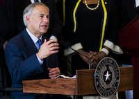Texas Gov. Greg Abbott speaks during a press conference on Friday at Dallas City Hall.(<p>Ashley Landis/The Dallas Morning News</p>)