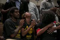 "<p></p><p>People pray during a service at Friendship-West Baptist Church in Dallas, July 10, 2016. The service largely focused on the two black men killed by police in Minnesota and Louisiana last week, along with the five police officers killed in Dallas. (Ilana Panich-Linsman/The New York Tim<wbr style=""orphans: auto;text-align:start;widows: 1;-webkit-text-stroke-width: 0px;  background-color:white;color:#333333;font-family:verdana, helvetica, arial, sans-serif;  font-size:12.8px;font-style:normal;font-variant:normal;font-weight:normal;  letter-spacing:normal;line-height:normal;text-indent:0px;text-transform:none;  white-space:normal;word-spacing:0px"">es</p>"