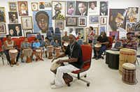 "<p><br></p><p>Community leader Baba Ifayomi Amuson (center) teaches how to play drums during a Community Sunday Drum Circle at the <a name=""firsthit"" id=""firsthit""></a>Pan African Connection Bookstore, Art Gallery and Resource Center in Dallas, Sunday, July 10, 2016. (Jae S. Lee/The Dallas Morning News)</p>"