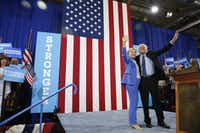 Hillary Clinton and Sen. Bernie Sanders, I-Vt. wave during a rally in Portsmouth, N.H.(Andrew Harnik/The Associated Press)