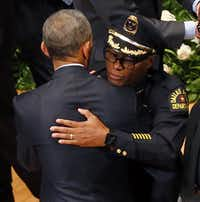 The president and Dallas Police Chief David Brown exchange hugs at Tuesday's memorial.(Tom Fox/The Dallas Morning News)