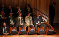 Five flag draped chairs President Barack Obama and First Lady Michelle Obama attend an interfaith memorial service for 5 fallen officers at the Morton H. Meyerson Symphony Center in Dallas, Tuesday, July 12, 2016.  The Obamas were joined by Vice-President Joe Biden and his wife Jill Biden, former President George W. Bush and First Lady Laura Bush.  Four Dallas police officers and one DART officer were gunned down last week in downtown Dallas at a protest rally. (Tom Fox/The Dallas Morning News)Tom Fox/Staff Photographer