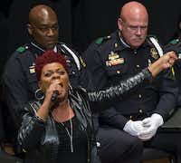 Gaye Arbuckle sings during an interfaith memorial service at the Morton H. Meyerson Symphony Center in Dallas on Tuesday, July 12, 2016, for five law enforcement officers killed last week in an ambush at a Black Lives Matter rally.  (Smiley N. Pool/The Dallas Morning News)Smiley N. Pool/Staff Photographer