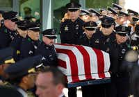 Police pallbearers with the casket of Lorne Ahrens at Prestonwood Baptist Church in Plano on Wednesday.(Tom Fox/The Dallas Morning News)