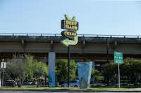 The Deep Ellum, Texas, sign on the corner of Main Street and Good Latimer Expressway points the way to the neighborhood. (Ting Shen/Staff Photographer)