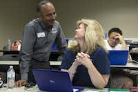 UTD computer science professor Jey Veerasamy works with Mardalee Burwitz during a UTeach programming and coding camp for teachers at the University of Texas at Dallas in Richardson.(Allison Slomowitz/Special Contributor)