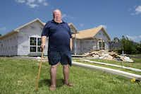 Michael Thompson, whose Garland home was severely damaged by the tornado that tore through his neighborhood last December, stands in front of his new home, which will be a bit bigger than his last.  (Jeffrey McWhorter/Special Contributor)