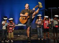 Singer and songwriter Eddie Coker of Colorado has volunteered at Camp Bravo for decades. He leads the children in a performance at the end of the camp's four-day run.(David Woo/Staff Photographer)
