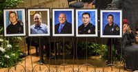 Photos of the fallen officers at a memorial service Tuesday in the Morton H. Meyerson Symphony Center.(Smiley N. Pool/The Dallas Morning News)