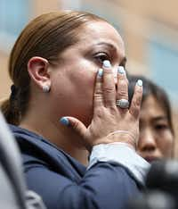 Maritza Ramos, widow of slain New York Police Department detective Rafael Ramos, talks to the media during a visit to the memorial at the Dallas Police headquarters in Dallas on July 15, 2016. (Rose Baca/Staff Photographer)