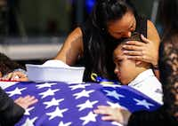"""<p><span style=""""font-size: 1em; line-height: 1.364; background-color: transparent;"""">Kristy Villasenor, girlfriend of Dallas police officer Patrick Zamarripa, shares a moment with her son, Dylan, after a </span><a name=""""firsthit"""" id=""""firsthit"""" style=""""font-size: 1em; line-height: 1.364; background-color: transparent;""""></a><span style=""""font-size: 1em; line-height: 1.364; background-color: transparent;"""">funeral service for Zamarripa on Saturday.</span></p>(Ashley Landis/The Dallas Morning News)"""
