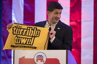 """Speaker of the House Rep. Paul Ryan, R-Wis., holds a """"Terrible Towel"""" during a breakfast Monday with Pennsylvania delegates during the Republican National Convention — a big step for a Packers fan.(Evan Vucci/Associated Press)"""