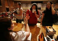 From left to right, Erica Torgerson, from Richardson, Aibi Nakae, from Dallas, and Alison Pittman, from Mckinney chat with Stephenie Meyer during her book signing event at Centennial High School in Frisco on May 10, 2008. (Kye R. Lee)