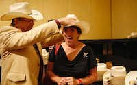 <p>Delegate Melanie Grammar of Randolph is fitted for her cowboy hat.</p>(Vernon Bryant/Staff Photographer)