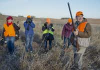 Sen. Ted Cruz R-Texas, right, is followed by cameras during a hunt hosted by Rep. Steve King R-Iowa, in Akron, Iowa, Saturday, Oct. 26, 2013. <br><p>AP Photo/Nati Harnik</p><p></p>