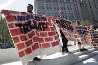Immigrant rights activists demonstrated against Republican presidential nominee Donald Trump on Wednesday in Cleveland.  Patrick Semansky/The Associated Press