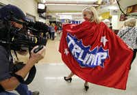 Minnesota delegate Mary Susan of Minneapolis shows off her Trump cape during the third day of the Republican National Convention on Wednesday, July 20.Vernon Bryant/Staff Photographer