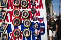 Vendors sell campaign buttons along Euclid Street on the third day of the Republican National Convention.(Smiley N. Pool/Staff Photographer)
