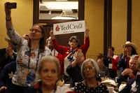 Maggie Wright stood to support Ted Cruz as he spoke to Texas delegates Thursday morning. (Vernon Bryant/Staff Photographer)