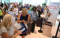 Passengers wait in line at the Southwest Airlines terminal at Dallas Love Field Airport in Dallas on Wednesday, July 20, 2016. Technical issues disrupted Southwest Airlines' operations system wide, including Love Field, grounding flights and causing long lines at airports across the country. (Rose Baca/The Dallas Morning News)(Staff Photographer)