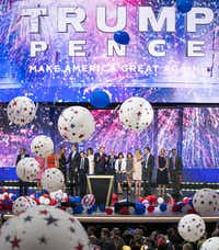 Donald Trump and Mike Pence celebrate with their families as balloons drop on the final night of the Republican National Convention.(Smiley N. Pool/Staff Photographer)