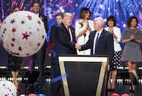 Donald Trump and Mike Pence shake hands as the Republican National Convention comes to a close in Cleveland on Thursday, July 21, 2016.(Smiley N. Pool/Staff Photographer)