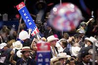 Members of the Texas delegation take down their state sign at the conclusion of the Republican National Convention on Thursday, July 21, 2016, in Cleveland. (Smiley N. Pool/Staff Photographer)