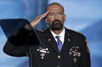 David Clarke, sheriff of Milwaukee County, Wis., saluted after speaking during the opening day of the Republican National Convention in Cleveland on Monday.(J. Scott Applewhite/The Associated Press)