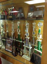 Travis' band trophies collected during Randy McCann's tenure as band director