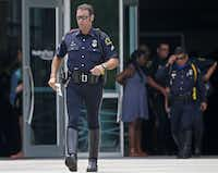 """Dallas motorcycle officer Adam Conway, a senior corporal, left the funeral for slain Baton Rouge Officer Matthew Gerald on Friday.(<p><span style=""""font-size: 1em; line-height: 1.364; background-color: transparent;"""">Jae S. Lee/Staff Photographer</span></p>)"""