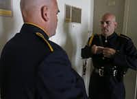 <br>(Dallas Sr. Cpl. William Rodriguez gets ready for the funeral of a slain Baton Rouge officer Friday. (Jae S. Lee /Staff Photographer))