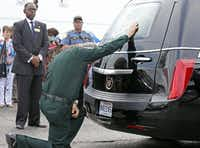 (East Baton Rouge Sheriff Sid Gautreaux placed a hand on the hearse carrying the casket of his slain deputy, Brad Garafola, Saturday. (Jae S. Lee / Staff Photographer))