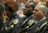 <br>(From left: DART Sgt. Tori Hutchins, Sgt. Cedric Roach and Officer Christopher Cobb attended the funeral of slain Deputy Brad Garafola in Baton Rouge on Saturday. (Jae S. Lee /Staff Photographer))