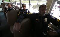 <br>(DART officers Christopher Cobb, Sgt. Schkennia Smith and Sgt. Cedric Roach rode a shuttle to the service for Brad Garafola. (Jae S. Lee / Staff Photographer))