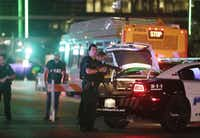 (Dallas police block streets near where a gunman shot and killed five officers on July 7. (Mark Mulligan / Houston Chronicle))