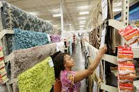 Martha Smith, of Carrollton, shops for rugs inside an At Home location on Stemmons Freeway in Lewisville, Texas on June 10, 2014. At Home recently changed its name from Garden Ridge. (Andy Jacobsohn/The Dallas Morning News) (Staff Photographer)