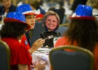 <p>A Hillary Clinton face cutout joined delegates from Beaumont for the Texas delegation breakfast. (Ashley Landis/Staff Photographer)</p>