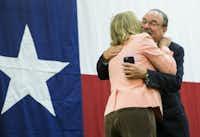 <br>(Texas Sen. Sylvia Garcia embraced state Democratic Chairman Gilberto Hinojosa at the Texas delegation breakfast Monday. (Ashley Landis/Staff Photographer))