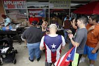 <p>At the recent chinchorreo in Fort Worth, the line was long for food, including <i>escabeches de molleja</i> (marinated gizzard), <i>guineo </i>(plantains) and <i>pinchos de puerco</i> (pork on a stick.)</p>(Ben Torres/Special Contributor)