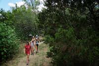 """<p>Students from Richardson's J.J. Pearce High School<span style=""""font-size: 1em; line-height: 1.364; background-color: transparent;"""">hike at Cedar Hill State Park during a summer visit.</span></p>(Lawrence Jenkins/Special Contributor)"""