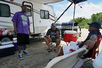 "<p><span style=""font-size: 1em; line-height: 1.364; background-color: transparent;"">Rufus Moore Jr. (from left), Angel Colon and Alex Flores hang out on the camp grounds at Cedar Hill State Park.</span></p>(Lawrence Jenkins/Special Contributor)"