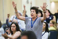 Hillary Clinton supporters booed Bernie Sanders supporters during the Texas delegation breakfast before day two of the Democratic National Convention on Tuesday.(Ashley Landis/Staff Photographer)