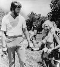 Former TCU basketball player Stan Farr and Priscilla Davis hold hands at the Colonial Country Club. She was in the process of divorcing husband Cullen Davis when Farr was killed and Priscilla Davis was wounded at the Davis Mansion in Fort Worth.(File Photo)