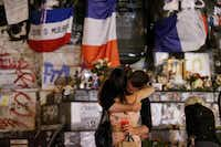 TOPSHOT - People stand in front of the place de la Republique's monument in Paris, on July 26, 2016 after a priest was killed in the Normandy city of Saint-Etienne-du-Rouvray in the latest of a string of attacks against Western targets claimed by or blamed on the Islamic State jihadist group.(GEOFFROY VAN DER HASSELT/AFP/Getty Images)