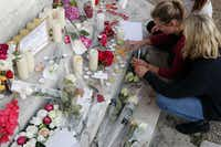 Flowers, candles and messages are placed on the city hall entrance closed to the home of Father Jacques Hamel.(Francois Mori/AP)