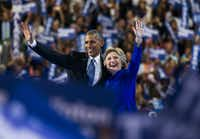 President Barack Obama and presidential candidate Hillary Clinton waved to supporters after Obama's speech Wednesday.(Ashley Landis/Staff Photographer)