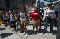 Supporters of undocumented immigrants chant during a rally at City Hall in Philadelphia on July 25, 2016, as Democrats gather to formally annoint Hillary Clinton as their candidate for the November presidential election at the Democratic National Convention. / AFP PHOTO / NICHOLAS KAMMNICHOLAS KAMM/AFP/Getty Images(AFP/Getty Images)