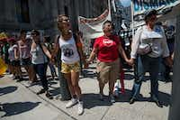 Supporters of undocumented immigrants chant during a rally at City Hall in Philadelphia on July 25, 2016, as Democrats gather to formally annoint Hillary Clinton as their candidate for the November presidential election at the Democratic National Convention. / AFP PHOTO / NICHOLAS KAMMNICHOLAS KAMM/AFP/Getty ImagesAFP/Getty Images